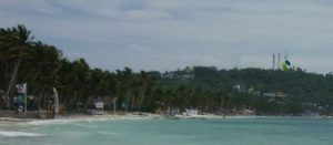 Bulabog Beach - we can see that it is windy, flags, a kite surfer
